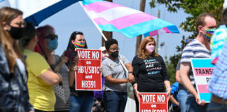 Opponents of several bills targeting transgender youth attend a rally at the Alabama State House to draw attention to anti-transgender legislation introduced in Alabama on March 30, 2021 in Montgomery, Alabama.