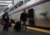Passengers prepare to board an Amtrak train.