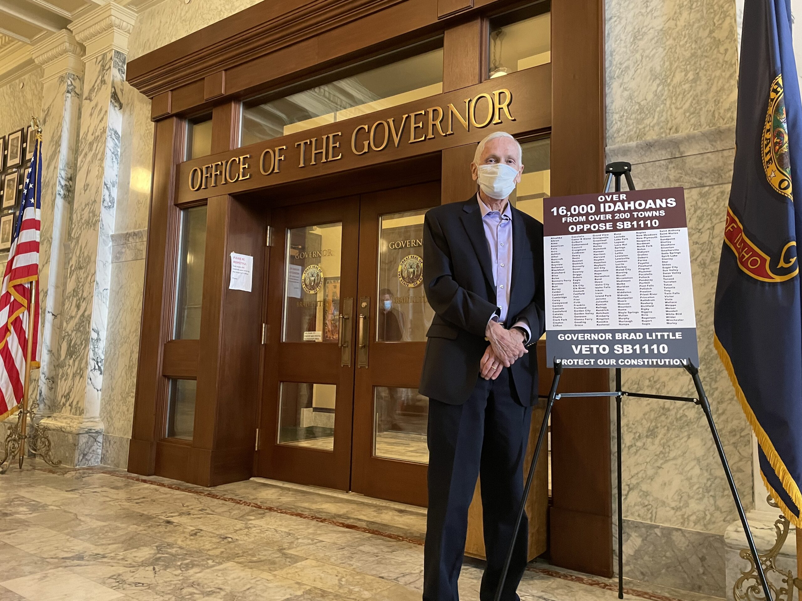 Jim Jones stands in front of Gov. Brad Little's office before handing over a petition with 16,000 signatures calling on the governor to veto a bill expanding requirements for ballot initiatives.