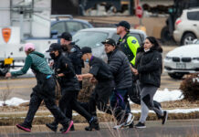 Shoppers are evacuated from a King Soopers grocery store after a gunman opened fire on March 22, 2021, in Boulder, Colorado.