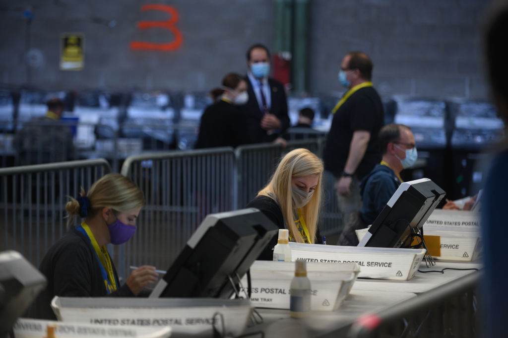 election officials proceed with the counting of ballots at the Allegheny County elections warehouse on Nov. 6, 2020,