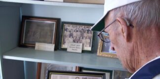 Grandpa looking a historic photos in Chesterfield