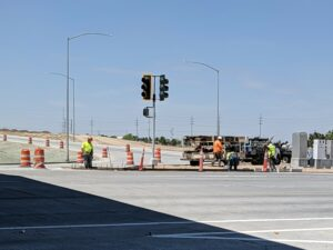 Construction workers work on a project at the I-84 Northside Boulevard Nampa interchange
