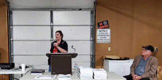 Angel Cushing, a north-central Kansas resident who opposes the proposed National Heritage Area designation in Kansas and Nebraska, speaks at a May 13 meeting in Marshall County, Kansas, as Norman Kincaide, a Colorado activist who opposes National Heritage Areas, looks on. (Screen capture from Facebook live video)