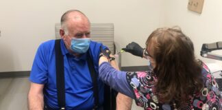 Jerry Kramer getting a COVID-19 vaccine at St. Luke's Health System in February