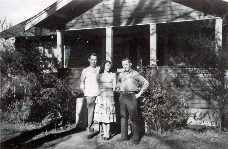 Larry, Mary and David Ertter stand in front of their family home on 6th Street as teenagers.