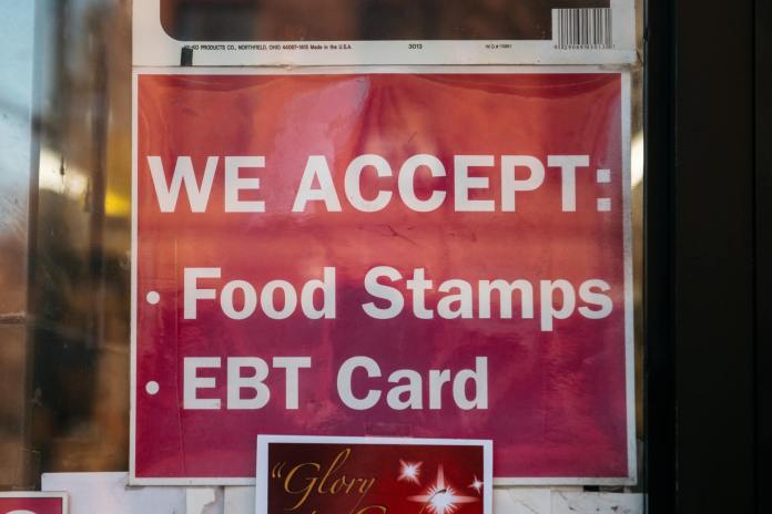 Food stamps sign hangs in a business