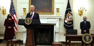 Joe Biden speaks at a gathering with Kamala Harris and Dr. Anthony Fauci