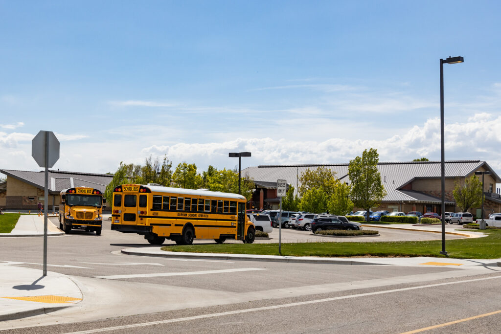A school bus arrives at Morley Nelson Elementary in Boise