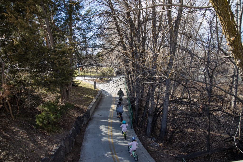 A family on the Greenbelt in Boise