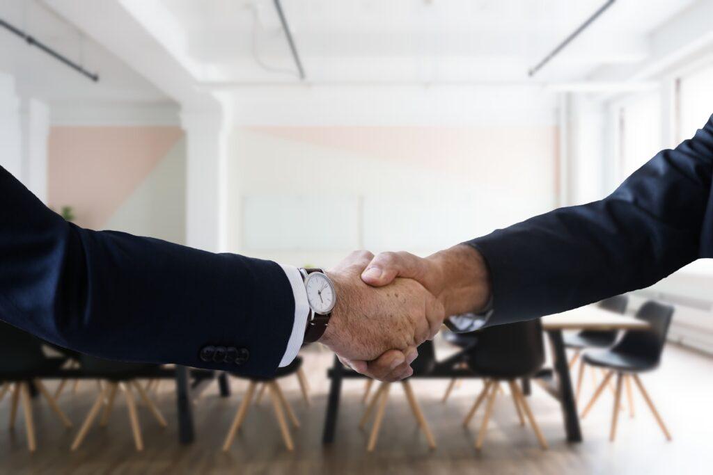 Job seeker and interviewee shake hands
