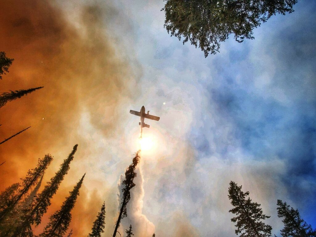 Plane drops water on wildfire