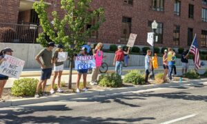 A small group protests COVID-19 vaccine requirements outside St. Luke's Boise Medical Center in July.