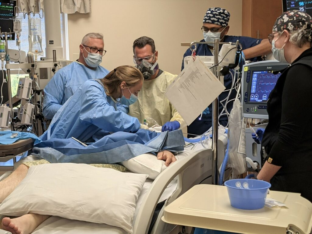 Saint Alphonsus doctors and nurses perform a tracheostomy on a patient in the ICU after COVID-19