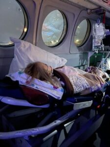 Photo of Charlotte McCabe, age 2, being transported in an air ambulance to Utah