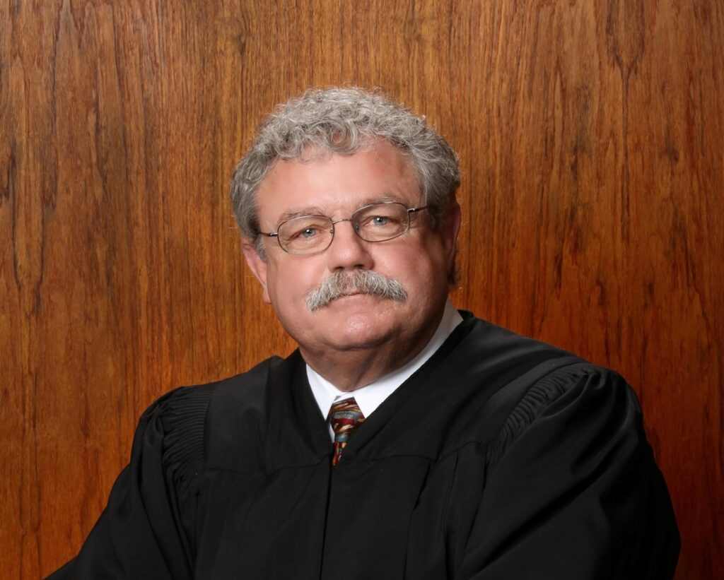 Justice Roger Burdick