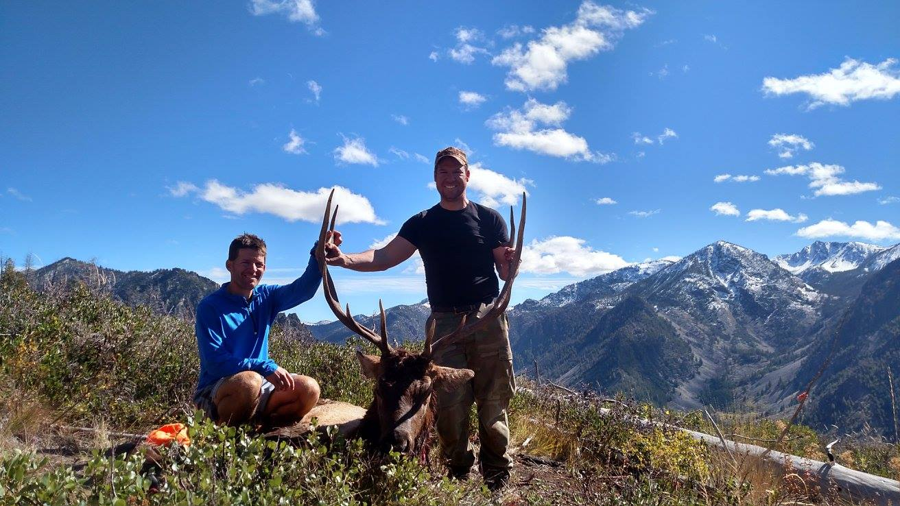 Photo of hunters with a bull elk in the Pahsimeroi Mountains